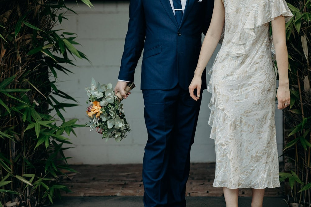 Natural photos of Bride and Groom walking through Fortitude Valley - Bride and groom silhouette - by Cloud Catcher Studio