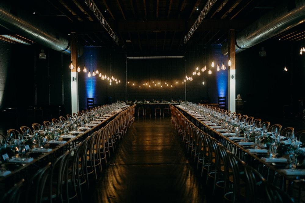 Wedding Reception set up featuring retro lighting design in Lightspace by Cloud Catcher Studio