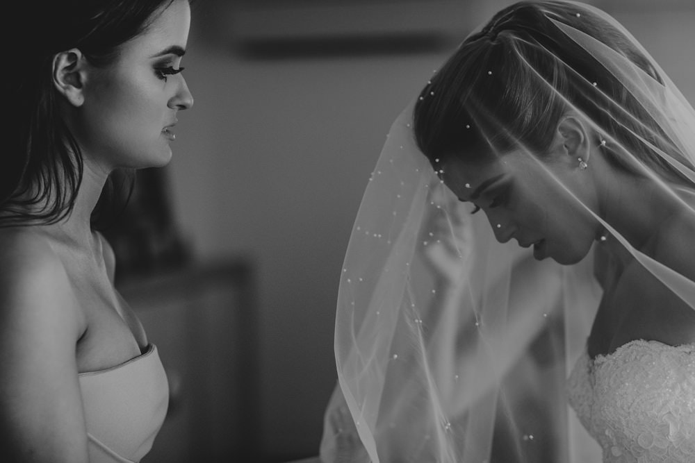 Bride and her Maid of Honour with the Veil before Moda Portside Wedding by Cloud Catcher Studio