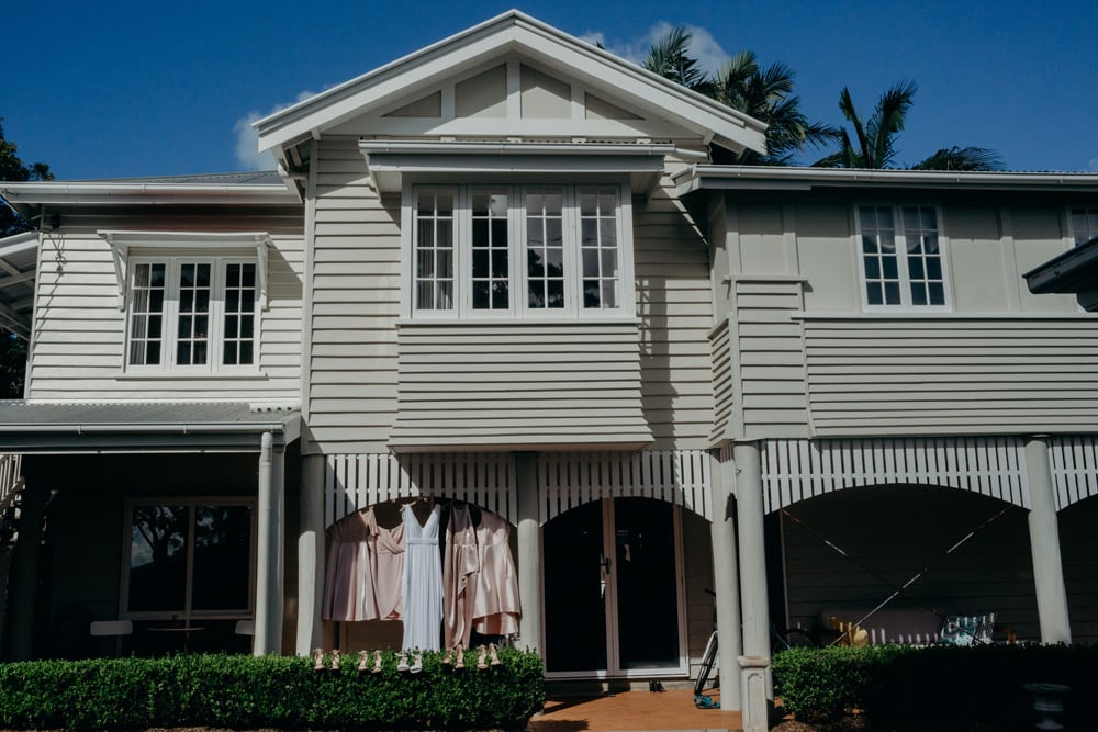 Bride and bridesmaids dresses hanging in Buderim holiday home - Buderim Wedding by Cloud Catcher Studio