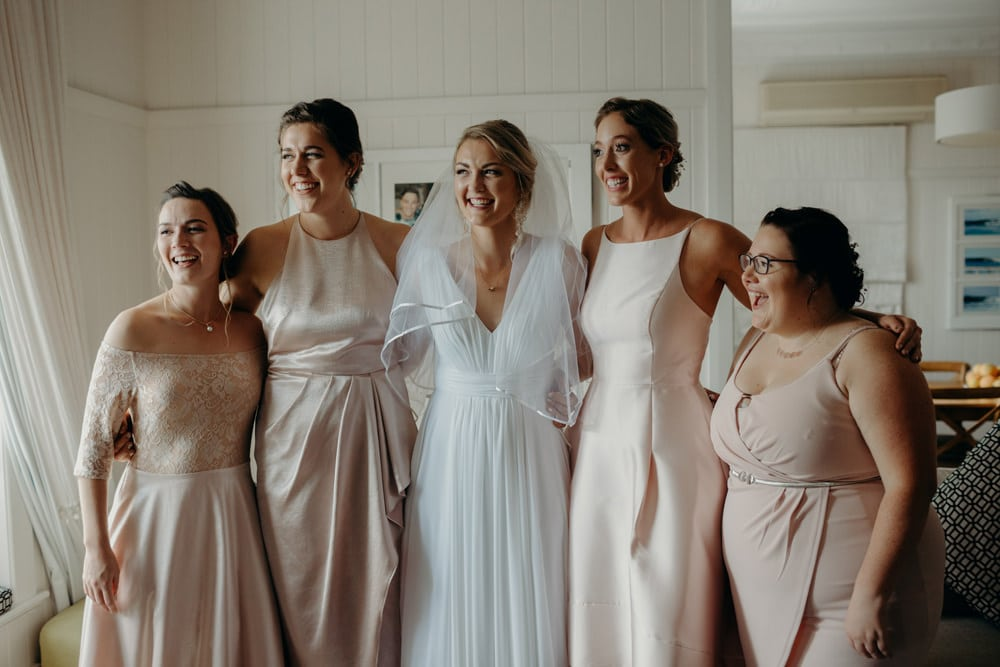 Candid photo of bride and her bridesmaids - Buderim Wedding by Cloud Catcher Studio