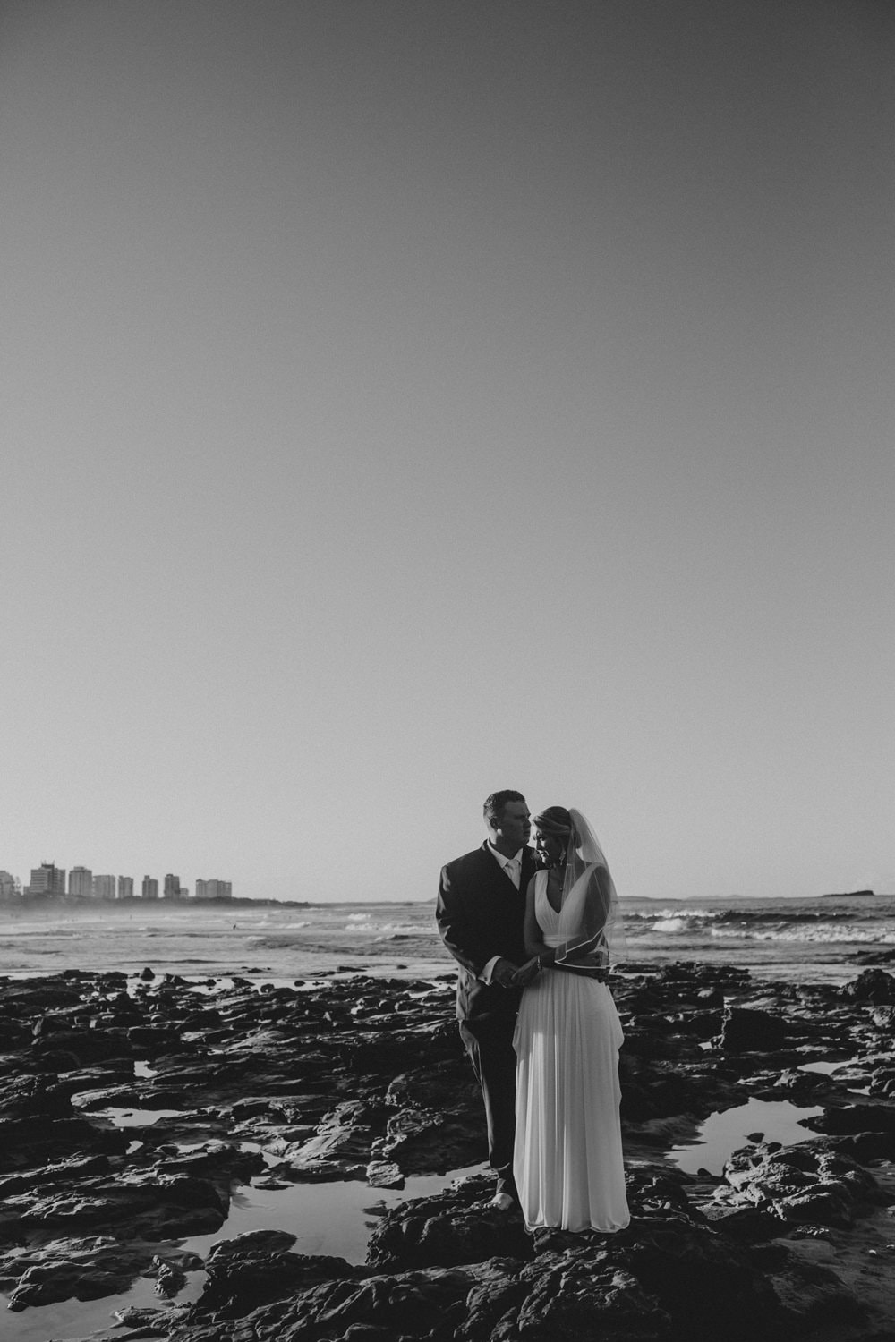 Candid photo of bride and groom on the beach, Sunshine Coast Buderim Wedding by Cloud Catcher Studio