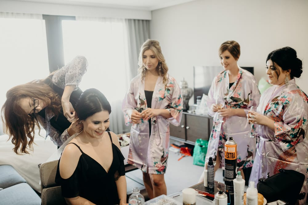 Bride and bridesmaids getting ready at Sofitel Brisbane City Wedding by Cloud Catcher Studio
