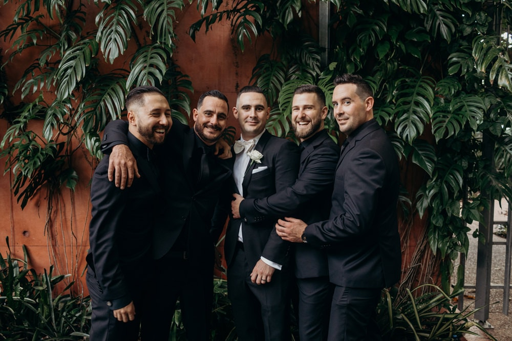 Unposed photo of groomsmen - Roma Street Parkland Wedding