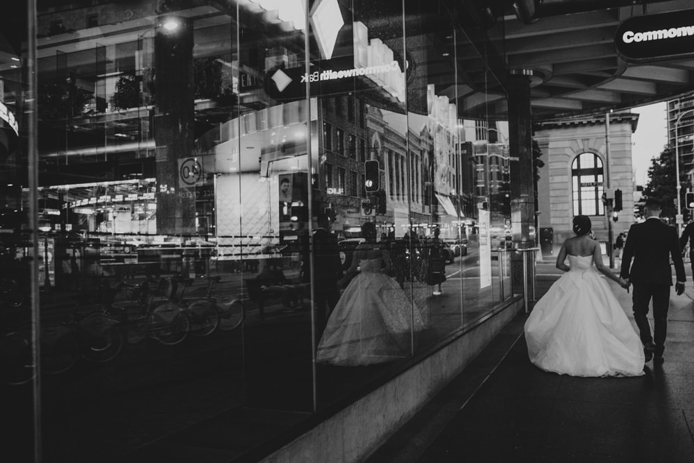 Bride and Groom walking through Queen Street in Brisbane at night
