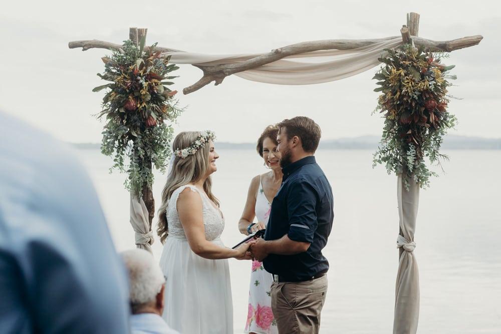 Wedding ceremony on Lake Weyba Noosa Springs Resort Wedding by Cloud Catcher Studio