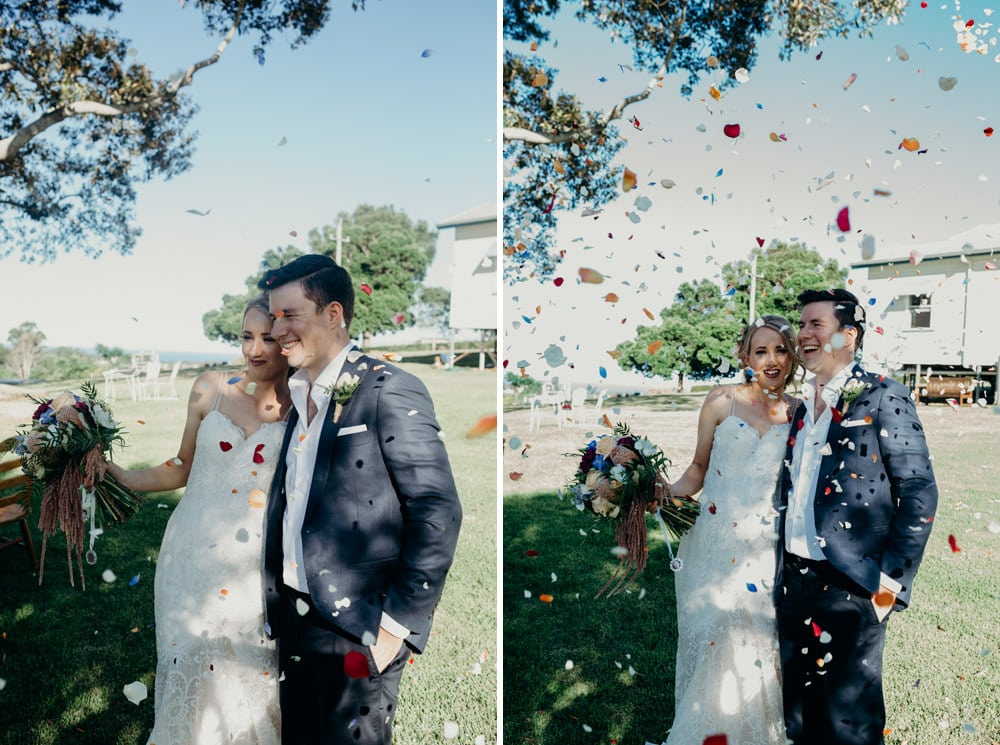 Bride and Groom are showered in confetti at their Byron Bay wedding by Cloud Catcher Studio