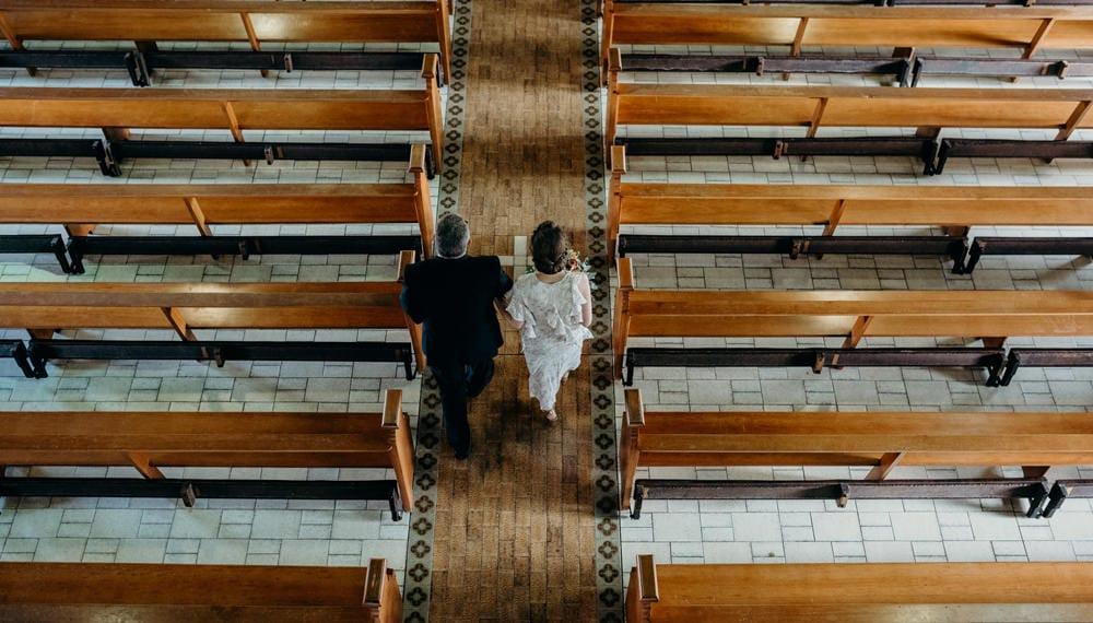 Bride and her father walk into St Brigids Church Brisbane Brisbane wedding by Cloud Catcher Studio