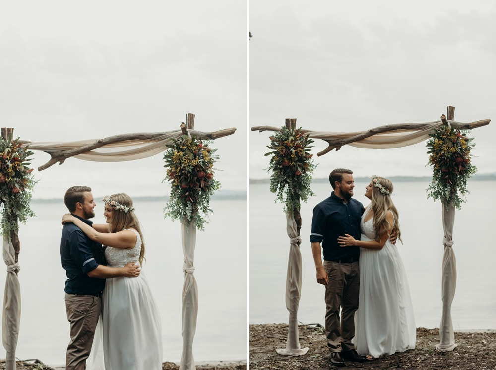 Bride and groom laughing by the lake at Noosa Springs Resort Wedding by Cloud Catcher Studio