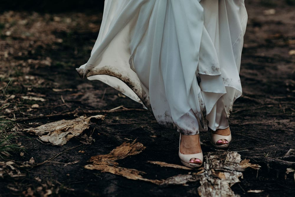 Adventurous Bride's shoes and muddy wedding dress at Noosa Springs Resort Wedding by Cloud Catcher Studio
