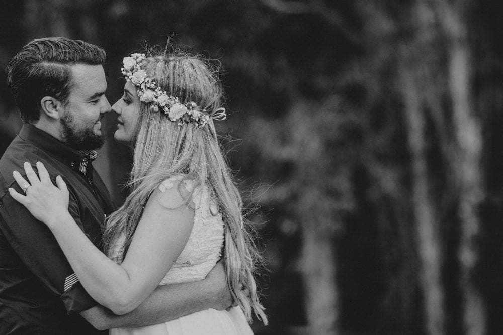 Candid photo of Bride and Groom kissing at Noosa Springs Resort Wedding by Cloud Catcher Studio