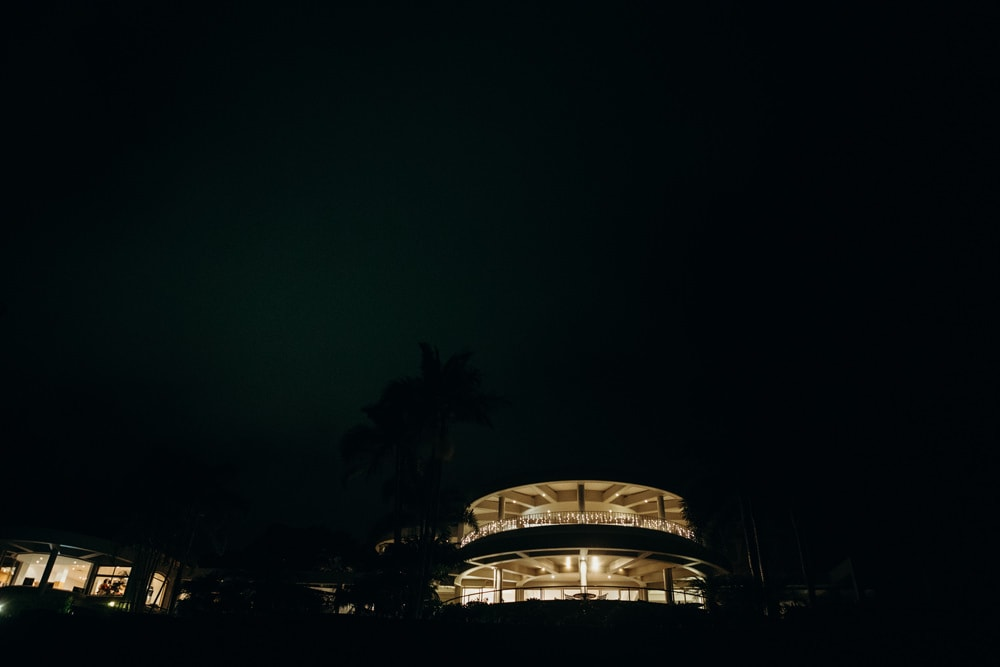 Night time photo of Noosa Springs Resort Wedding with fairylights by Cloud Catcher Studio