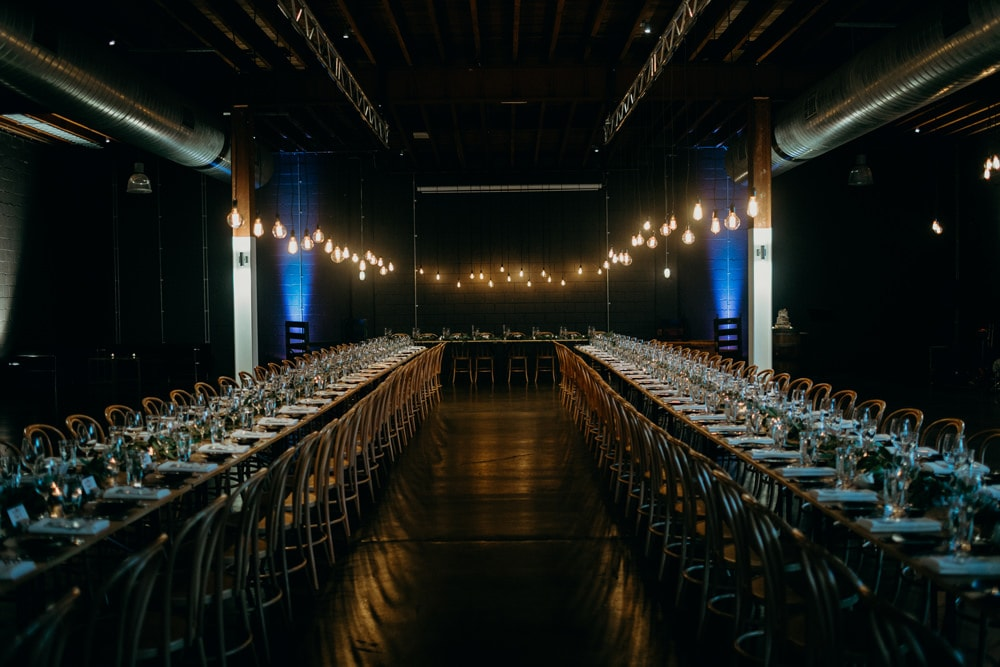 Wedding Reception set up featuring retro lighting design in Lightspace by Cloud Catcher Studio