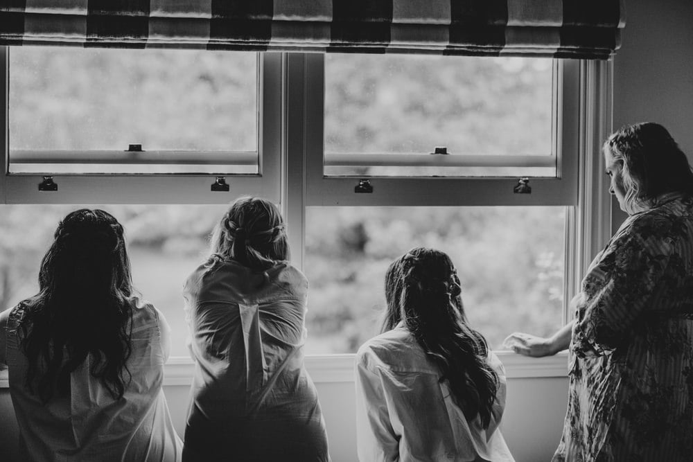 Bridesmaids peeking out window of Bridal Cottage at Spicers Clovelly Estate Wedding by Cloud Catcher Studio