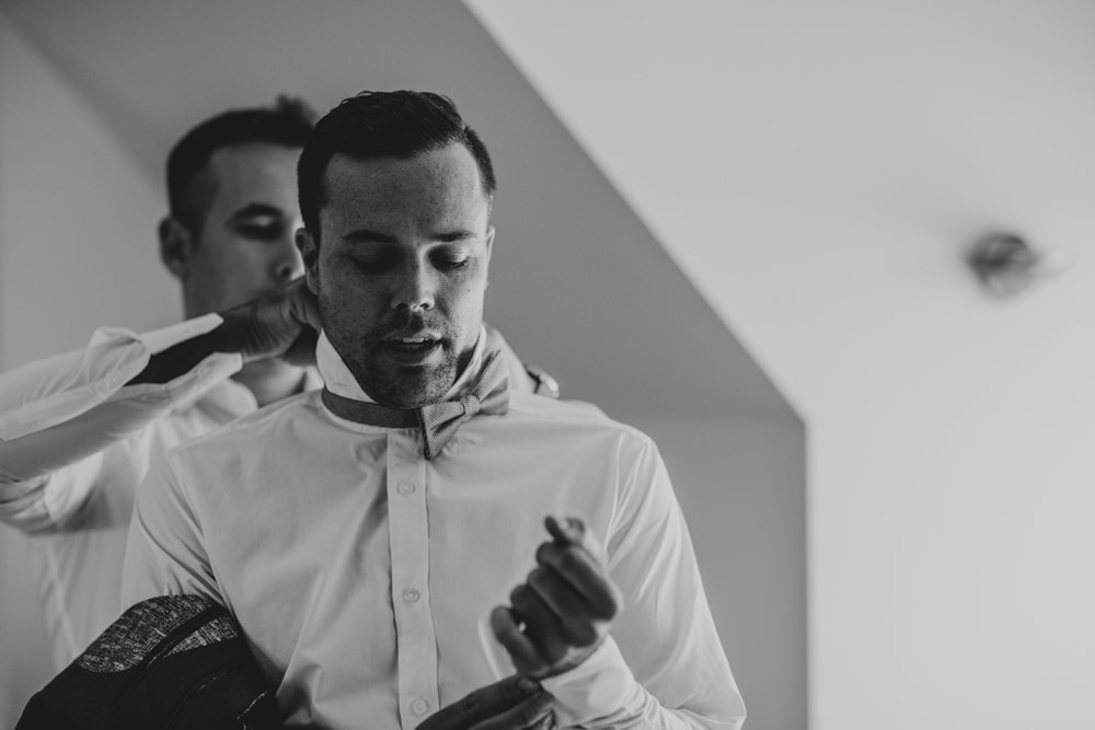 Candid photo of groom getting ready at Spicers Clovelly Estate Wedding by Cloud Catcher Studio