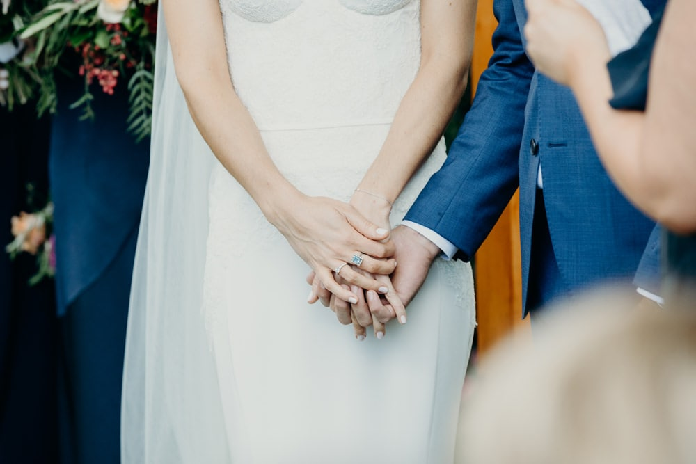 Bride and groom holding hands during ceremony at Spicers Clovelly Estate Wedding by Cloud Catcher Studio