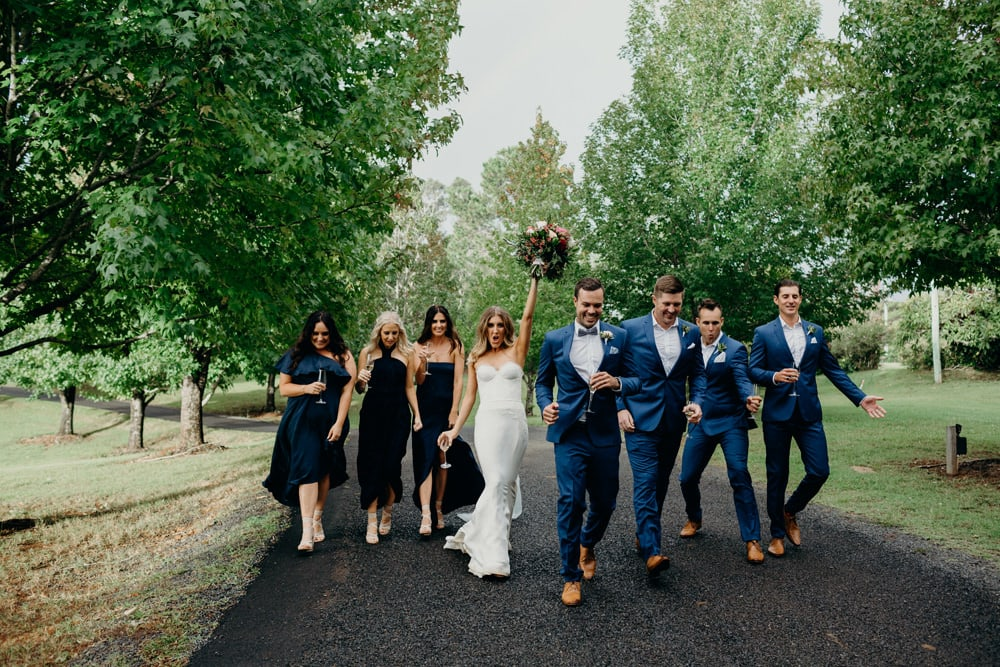 Bridal party in the rain at Spicers Clovelly Estate Wedding by Cloud Catcher Studio