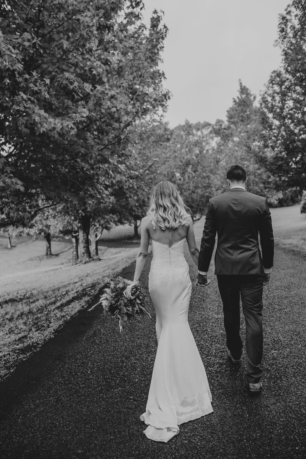 Bride and groom on the driveway at their Spicers Clovelly Estate Wedding by Cloud Catcher Studio
