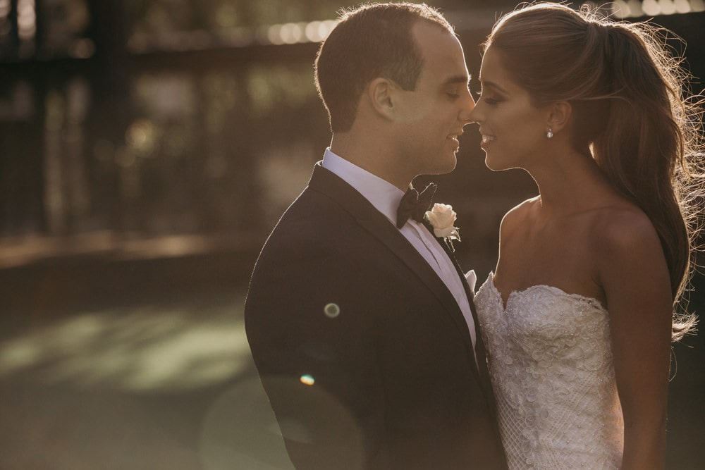 Bride and Groom Candid unposed photo at All Hallows Brisbane Wedding by Cloud Catcher Studio
