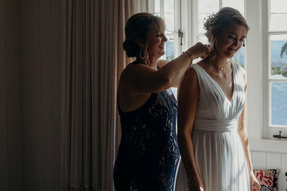 Bride being dressed by her mum on the morning of her Buderim Wedding by Cloud Catcher Studio