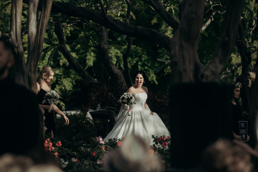 Bride arriving at Roma Street Parkland Palm Tree Court Brisbane City Wedding by Cloud Catcher Studio