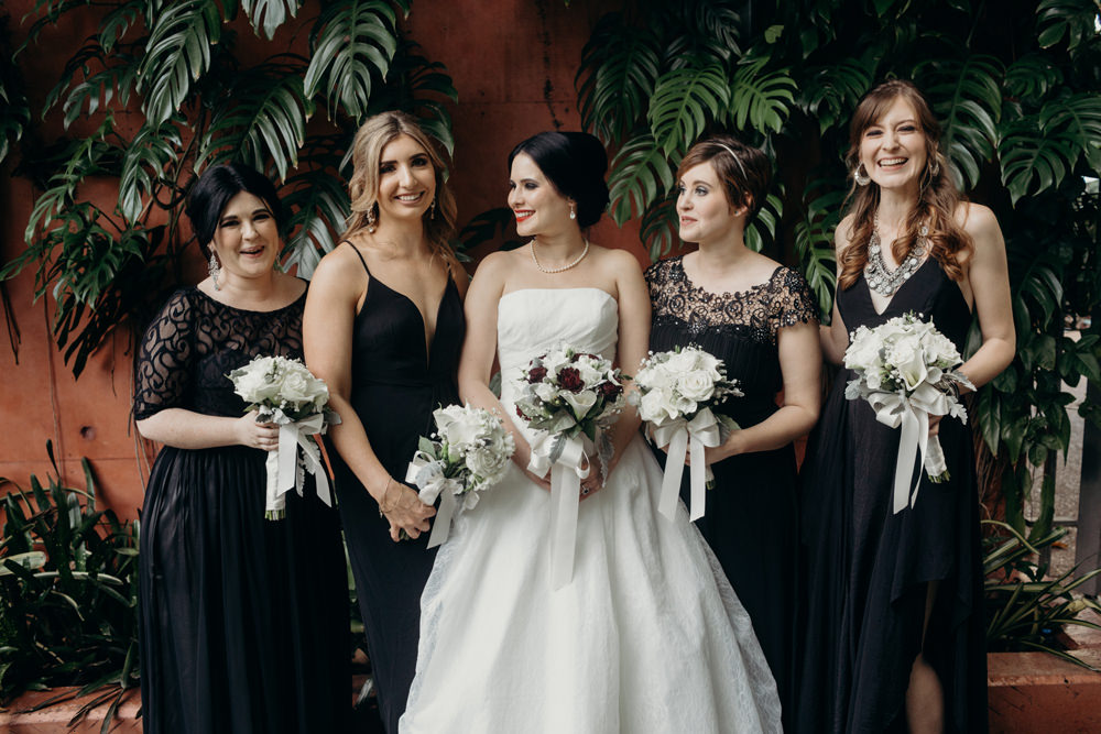 Unposed photo of bridesmaids - Roma Street Parkland Wedding