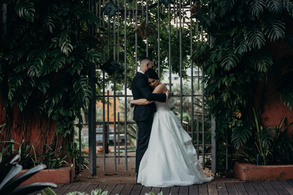 Candid photo of Bride and Groom in Roma Street Parkland Wedding
