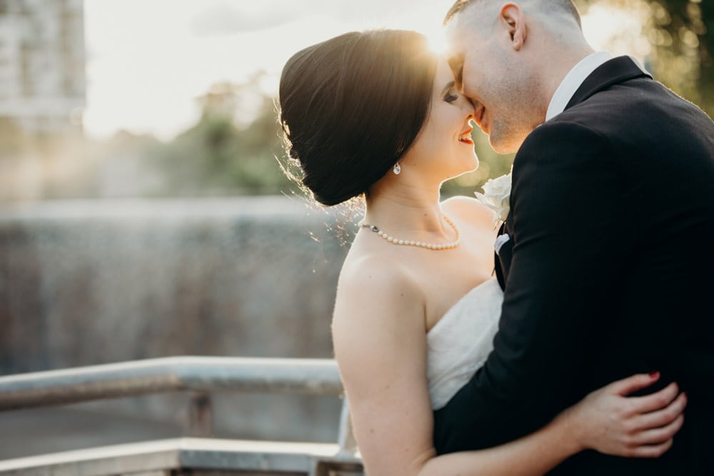 Candid photo of Bride and Groom at Roma Street Parkland